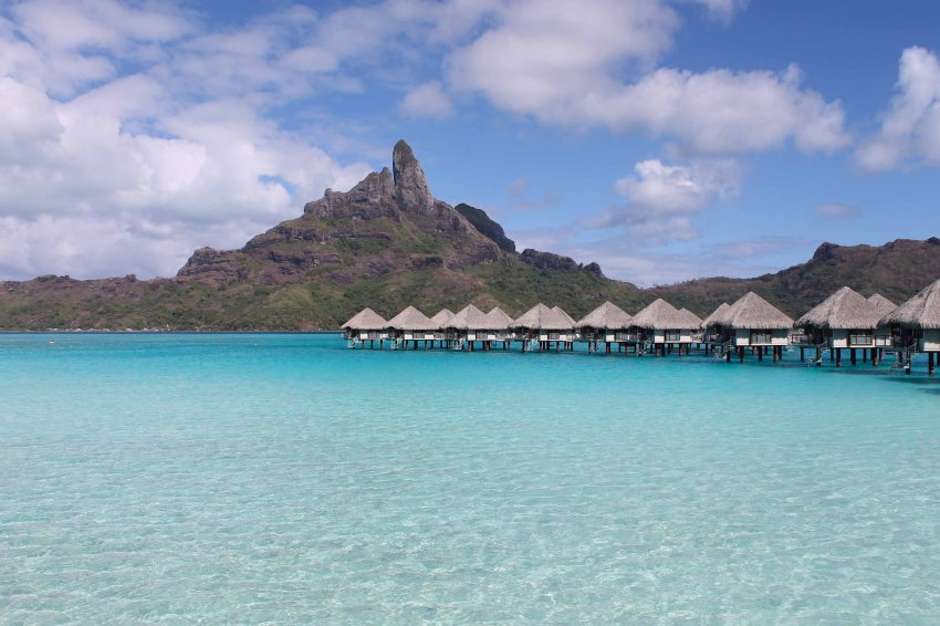 Overwater bungalows at Le Méridien Bora Bora and Mount Otemanu